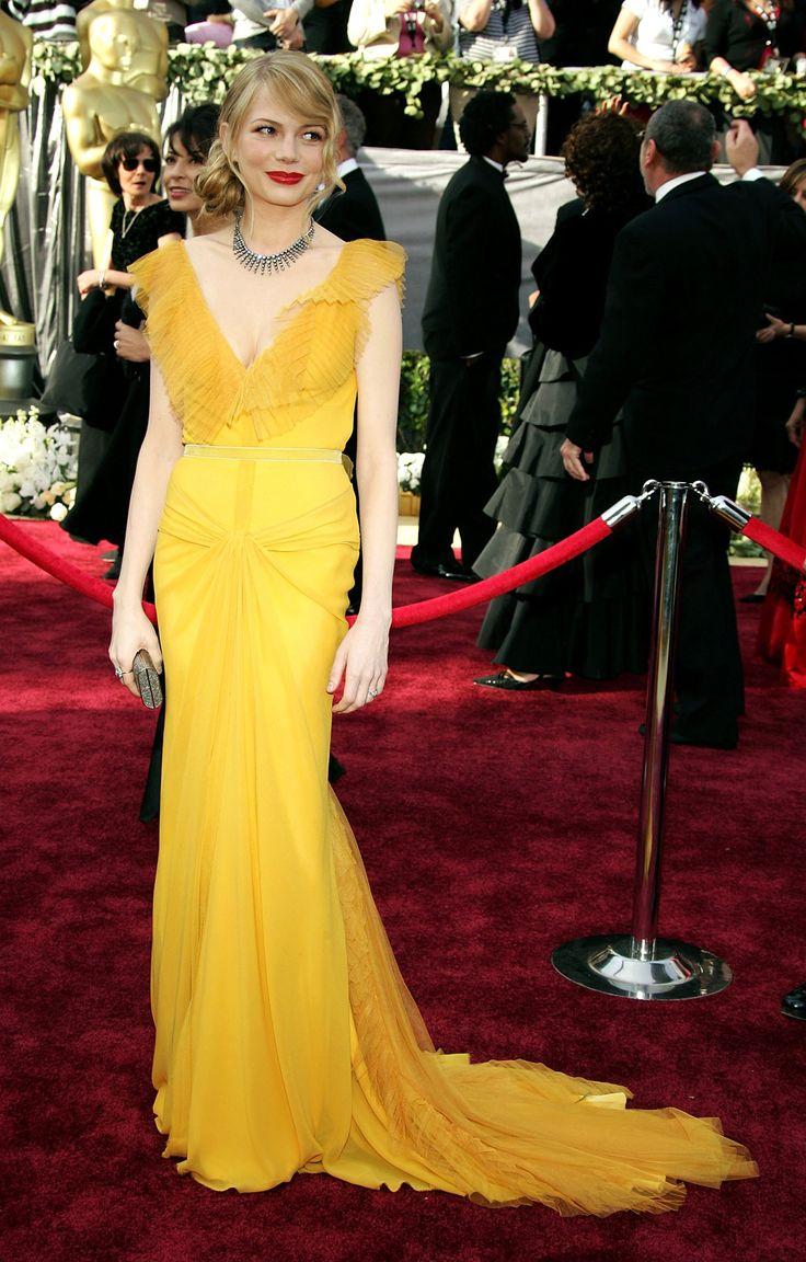 Celebrity Stylists Share Their Favorite Oscar Looks of All Time: We asked the stylists who will dress this year's stars (with plans of their own of making their mark on that carpet) to name their best of all time. ----- Michelle Williams in the  yellow saffron gown. Vera Wang | Coveteur.com