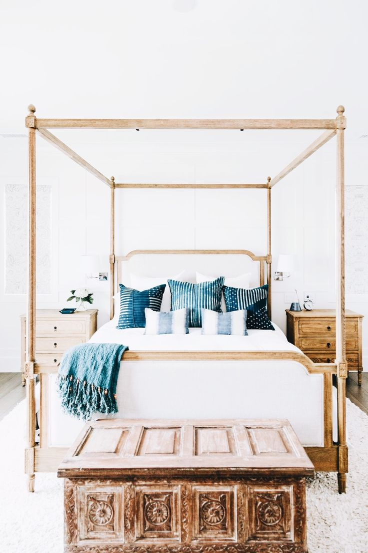 Elegant bedroom with some rustic touches for a cozy feel. Love the pops of blue.