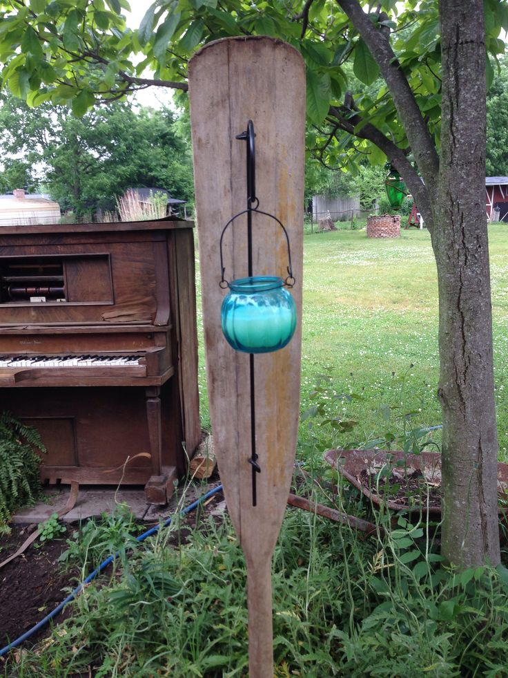 Old boat oar made into a outdoor candle holder...! Love to repurpose things!