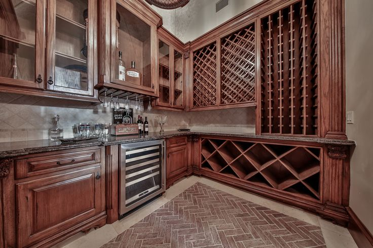 The wine grotto at Rosewood features a groin ceiling, granite countertops, herringbone pattern brick flooring, under counter wine refrigerator, wine glass storage, & storage for 500 of your favorite vintages.  #SupremeAuctions #LuxuryAuction #Houston #Dallas #Texas #HoustonRealEstate #TexasRealEstate #DallasRealEstate #Auction #LuxuryLiving #LuxuryHome #Mansion #RealEstate #LuxuryRealEstate #TheWoodlands #House #bedroom #LuxuryLifestyle #Rosewood #pool #idea #inspiration #wine #wineroom