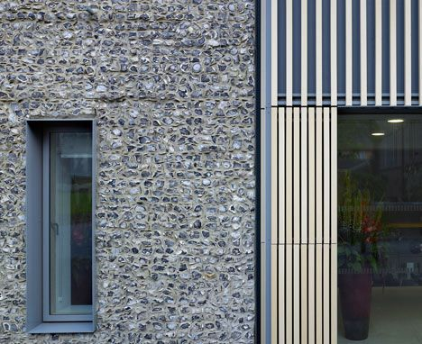 Flint wall & terracotta battens Brighton College by Allies and Morrison