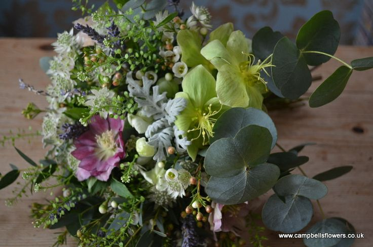 A seasonal bouquet full of texture in soft greys, sages and lavenders