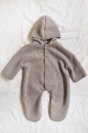 MAKIE Fleece jump suit bunting. Someone gave us this as a gift and it is incredibly soft, warm, and cozy. (Even a smaller baby can wear the larger size, it'll just be extra roomy)