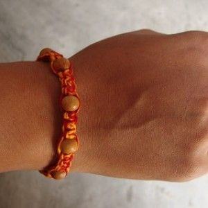 Chandan 7 Beads Rakhi Rs. 199.00 1 accurately gorgeous seven beads chandan Rakhi set with holy red and yellow thread beautifully designed on astrological principle. This rakhi will help your dear brother to enhance confidence . #rakhionlineindia #sendonlinerakhi #buyrakhionlineindia #sendrakhitoindia