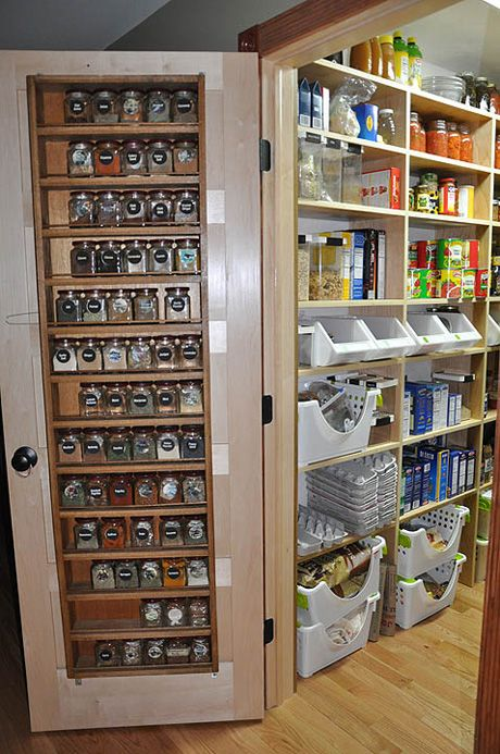 Shelves affixed to the inside door of this pantry keep spices organized and accessible. Via apartmenttherapy.com