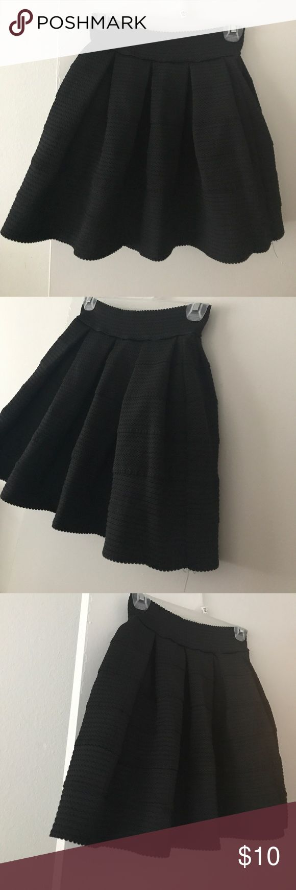 Playful Textured Pleated Skirt This skirt is heavy material. The waist is stretch so it provides a defined waistline. There is no zipper or button closure as it is a pull on skirt. Looks great with a dress shirt tucked in and even a t-shirt with flats. Super easy to look dressed up without trying. Excellent condition. Skirts
