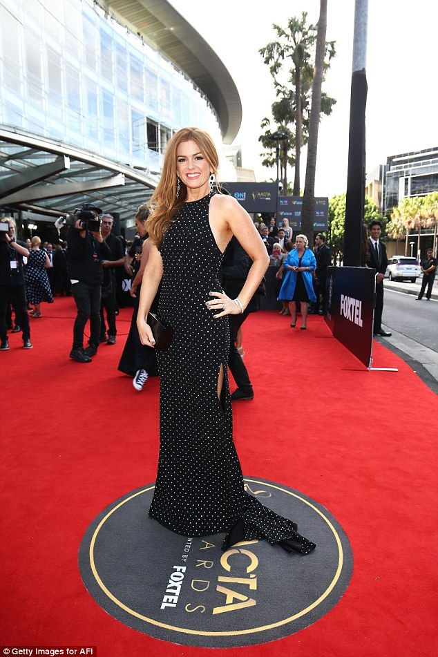 Stunning supporter: Isla recently supported the Australian designer,  sporting a sleek dotted Alex Perry halterneck frock at the 2016 AACTA Awards in Sydney last December