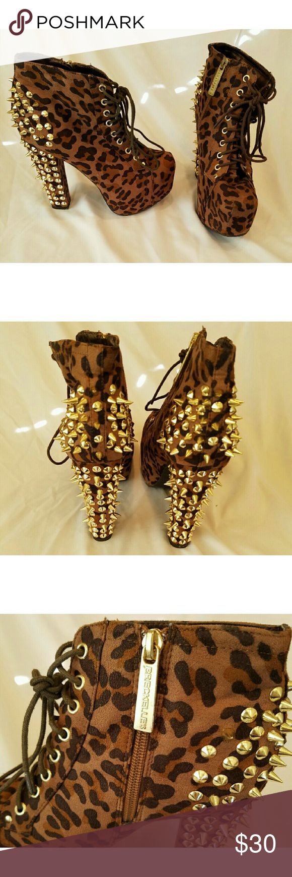 Studded cheetah heels Gold spiked cheetah heels. Worn once in perfect condition all the studs are there. Size 7 with a 5 inch heel. Breckelles Shoes