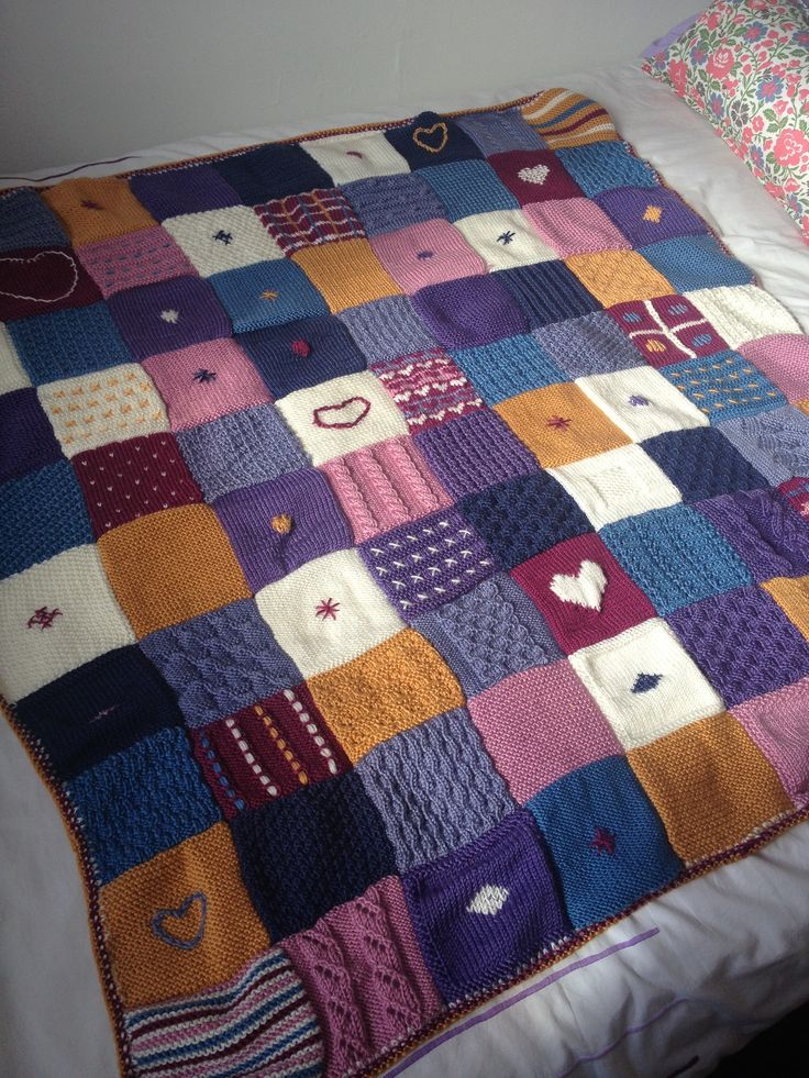 Patchwork knitted blanket. Love the heart!