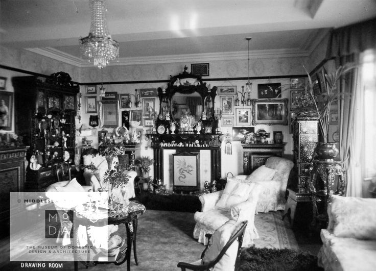 about1910 This is one of twenty-six photographs in a collection about a house on Barry Island near Cardiff in about 1910. The property's owners were connected with shipping in Newcastle and built the house for their son before World War One for £10,000. This photograph shows the home's typical turn of the century drawing room. The fireplace is large and uses decorative tiles. It has an elaborate overmantel that is used to display a variety of ornaments. The room has modern chintz covered…