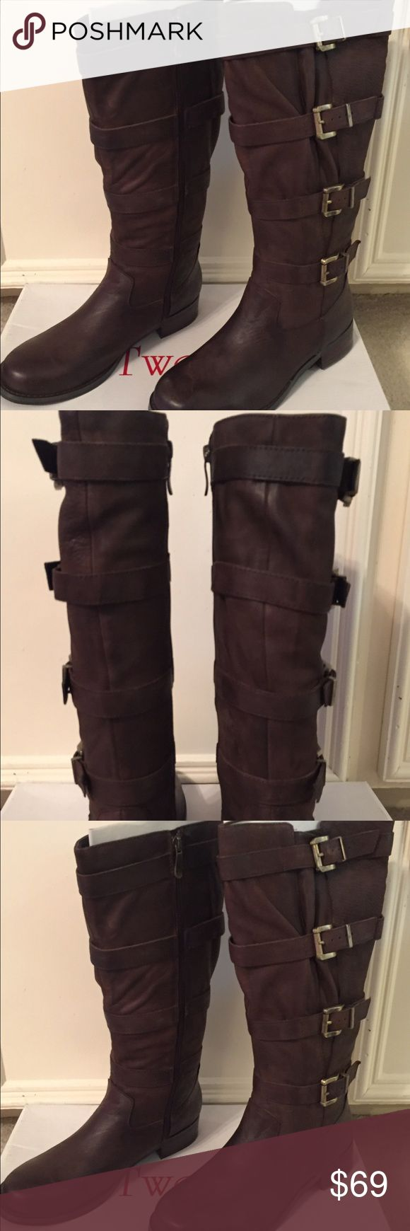 Women's brown boots size 9 NIB New women's dark brown boots size 9, upper leather. Small heel. Shoes Heeled Boots