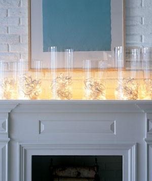 White christmas lights inside glass hurricane vases