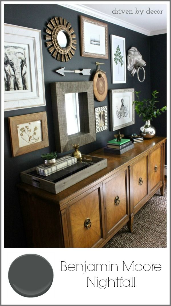 Love this dark moody charcoal gray! Love the art gallery wall and vintage buffet too!!