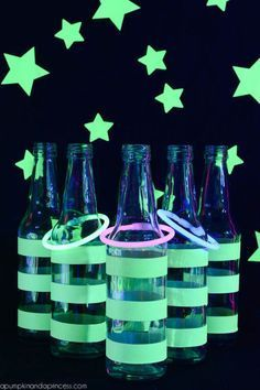 Wrap glow-in-the-dark duct tape around a few bottles and see how many glow stick bracelets kids can get around the bottle necks in this spooky game of Ring Toss. Click through for a tutorial and more Halloween games for this year's Halloween party.