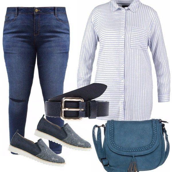 La lunga camicia portata sui jeans e stretta in vita dalla cintura, mette in risalto la zona alta , le righe in diverse direzioni aiutano a slanciare la figura e con le scarpine glitterate abbiamo un outfit comodo , femminile che strizza l'occhio agli anni'80!