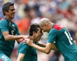 Mexico's Herrera celebrates scoring in overtime over Senegal with teammates Enriquez and Chavez in their men's quarter final soccer match at the London 2012 Olympic Games at Wembley Stadium in
