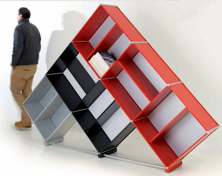 Pyramid bookcase in red, wblack and silver aluminum. Cm. 188 h x 267