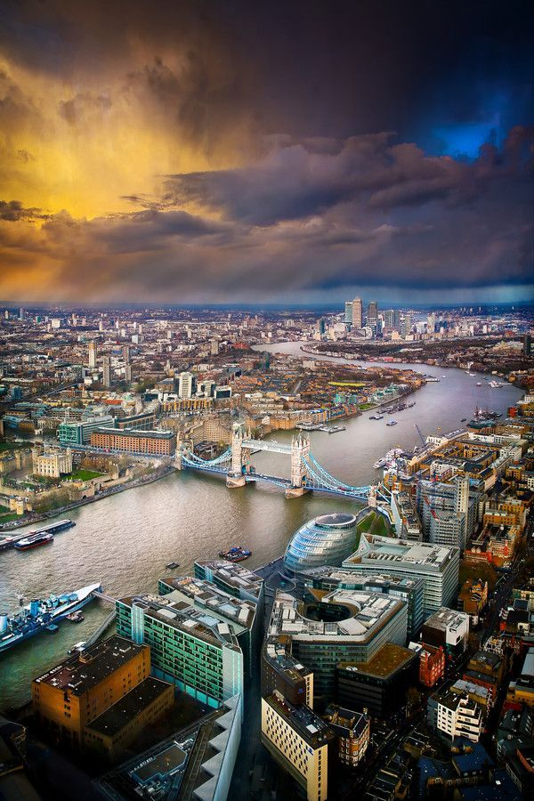 Stunning view over London that features some rather dramatic storm clouds. Taken from the View from the Shard by Les Kancir