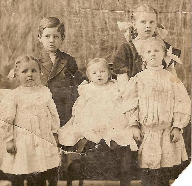 Children's photo  In the 1800's and 1900's posers had to stand very still for long periods of time when they had their picture taken. Around 1908.