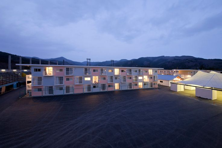 navigating the uneven terrain of the miyagi prefecture, structural frameworks hold three storeys of stacked shipping container units for temporary living. a central community center, market and atelier create warm areas for communal gathering.