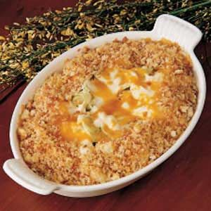Scalloped Cabbage Recipe  1/2 medium head cabbage, chopped (about 4 cups)  3 tablespoons vegetable oil  3 tablespoons all-purpose flour  1/2 teaspoon salt  Dash pepper  1 cup milk  1 cup (4 ounces) shredded cheddar cheese  3/4 cup bread crumbs  2 tablespoons butter, melted