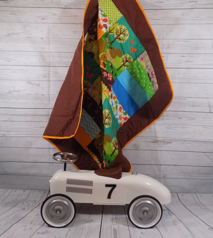 A personal favourite from my Etsy shop https://www.etsy.com/uk/listing/231274393/woodland-baby-quilt-squirrel-woodland