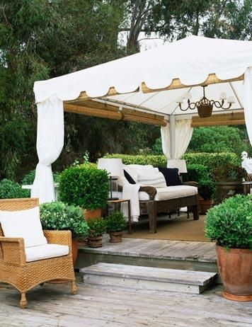 Garden Room A White Tent With Roll Up Bamboo Shades And A Sisal Rug Make