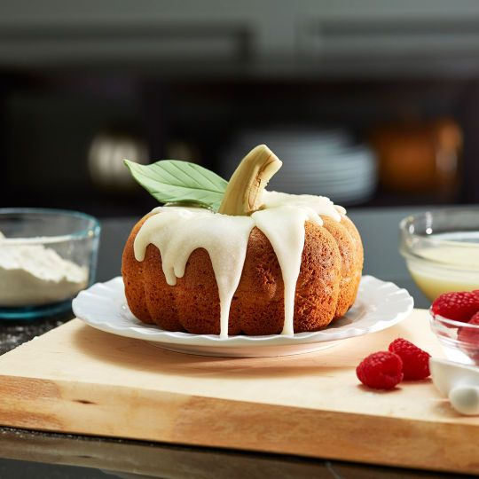 What better dessert to serve during fall than a delicious Pumpkin-Shaped Cake.
