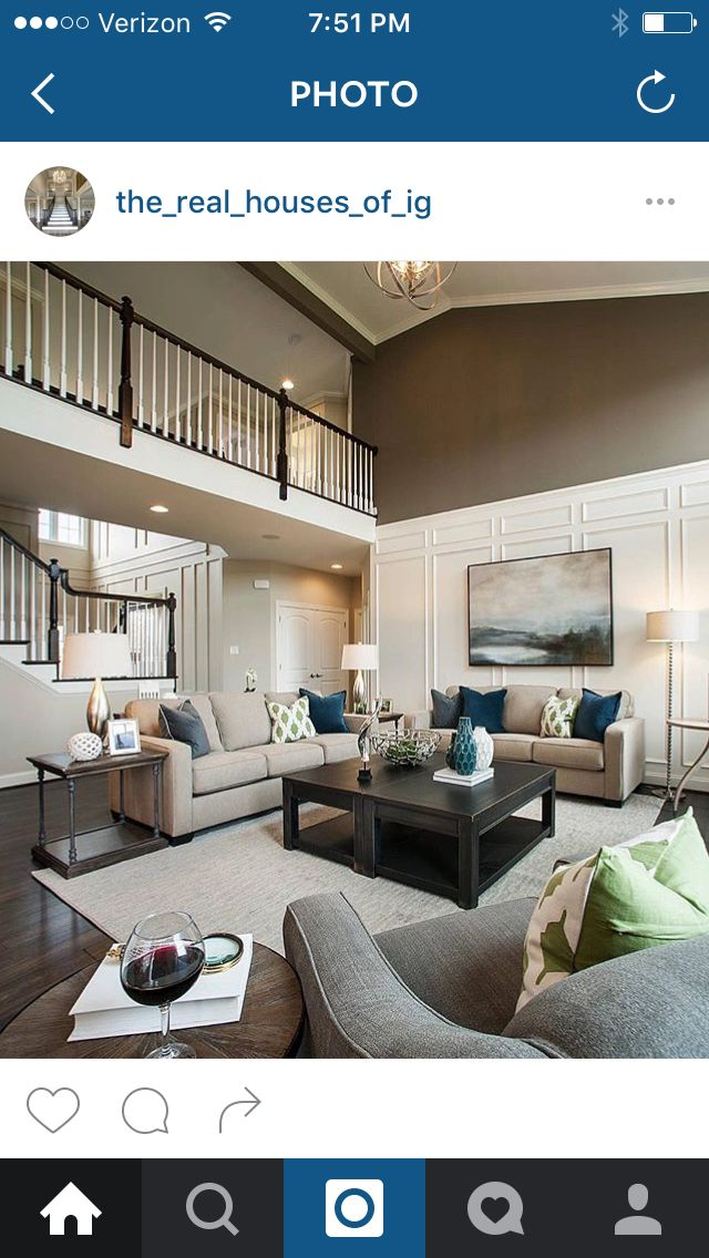 Two story family room with trim and moldings