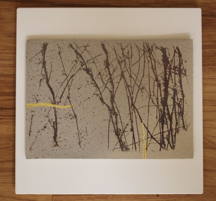Flawed (mended with gold) by Jo Hannah. Stoneware, Acrylic and Gold Leaf, mounted on wood.