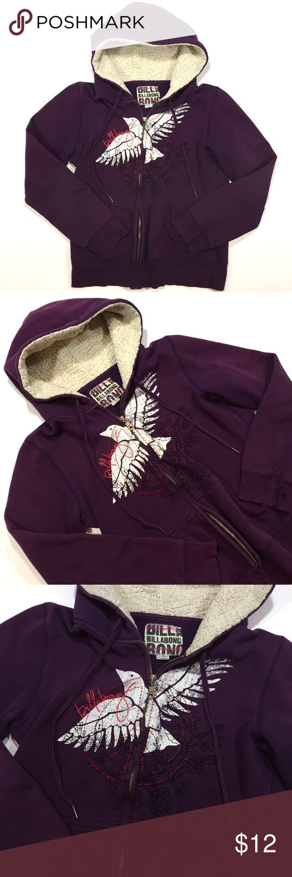 "Women's purple hood sweatshirt by Billabong - MED Girls purple hooded sweatshirt by Billabong. Cute stitched flower design along with white dove on front.  Quality metal zipper and handle has Billabong logo. Size Medium. Material: 97% Cotton, 3% Spandex. Pre-loved but has plenty of use left. There is slight wear on the sleeves (as shown in photos).   Measurements: Length - 23"" Top of Shoulder to sleeve - 23"" Armpit to armpit - 18.5"" Billabong Tops Sweatshirts & Hoodies"