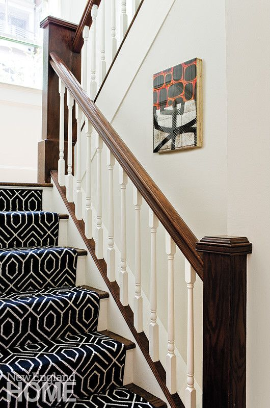 Climbing all four stories of the house, the graphic black-and-white stair runner forms a unifying backbone.