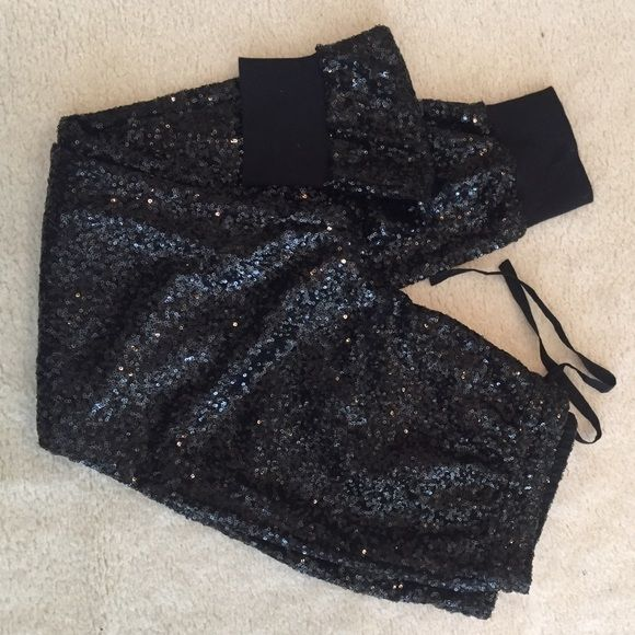 Victoria's Secret black sequin jogger pants Victoria's Secret black sequin jogger pants size small! Great for the holidays especially New Years. Easy to dress up and down. Never been worn or washed size small! Victoria's Secret Pants Track Pants & Joggers