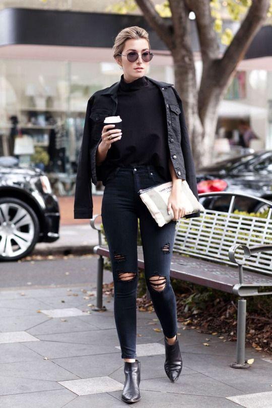 Black denim jacket, black oversized mock neck shirt, black skinny distressed jeans, black leather pointed toe ankle boots