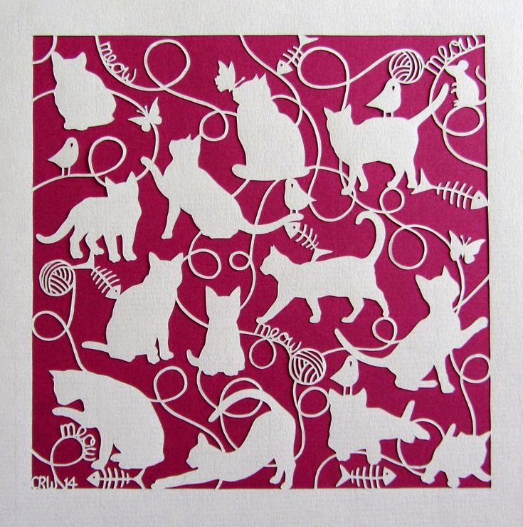 Hand cut paper cut of some playful cats. Features balls of string, butterflies, birds, fish bones, 'meows' and one little mouse!