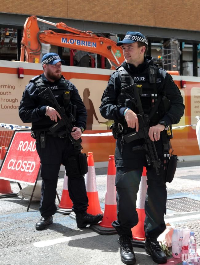 Armed Police officers stand by a cordon near London Bridge in London on June 4, 2017. Last night three terrorists killed seven people and…