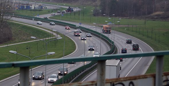 Highway Traffic by StockHunter Here is 18 seconds long video footage of a highway traffic at evening. In the picture you can see winding road ant vehicles passin