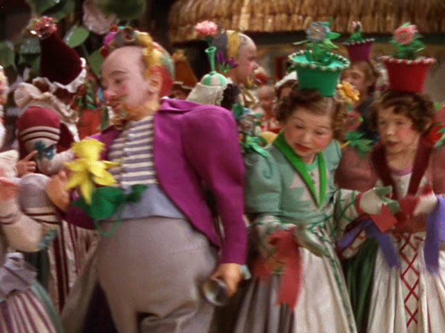 I can handle the flying monkeys and the talking apple trees, but to this day, the munchkins in THE WIZARD OF OZ freak me out! I have nothing against midgets, but theys guys look so creepy...a lot like clowns...[SHUDDERS]