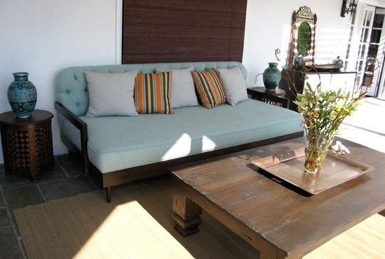 """Tuft-A-Bed Outdoor Daybed, $2875.35  Tufted outdoor daybed- mid-century modern-like teak frame with tapered legs in a chocolate stain, upholstered in aqua blue sunbrella fabric.  8'-0"""" L x 3'-0"""" OH x 4'-0"""" O; includes fabric.  Custom finishes, fabrics and COM available."""