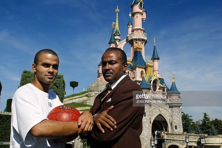 French NBA star basketball player Tony Parker poses with his father Tony Parker Senior 16 September 2003 at Disneyland Paris. The French defeat (67-69) against Italy for the bronze medal European Championship 2003 finals 14 September 2003 in Stockholm means that France does not qualify for the Olympic Games in Athens.