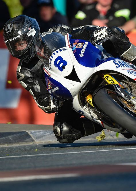 Guy Martin gets his knee down at the Isle of Man TT moto road race.