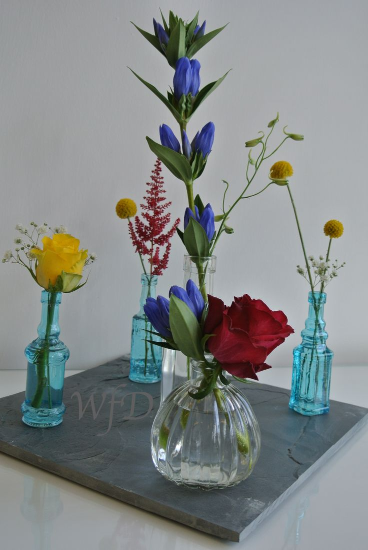 49 best our work table centrepieces venues images on retro table centrepiece medical bottles grey slate bright flowers reviewsmspy