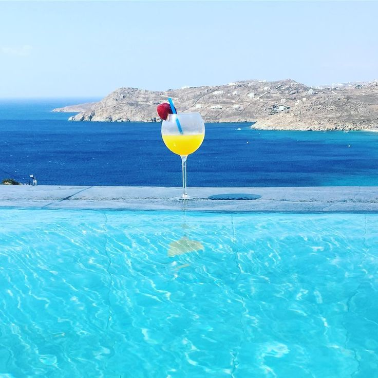 A refreshing cocktail with an amazing view!