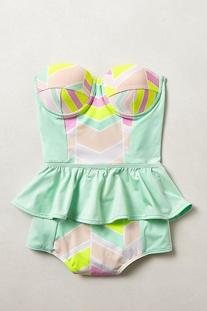 SUMMER VACATION MUST-HAVE:  How super cute is this swimsuit?  Love love love the pastel colors and ruffles. #Anthropologie #swimwear #frills