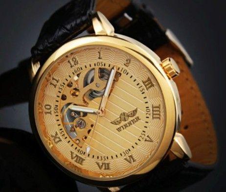 Luxusné pánske mechanické hodinky Winner v zlatej farbe. Sleduje svoj čas štýlovo s týmito luxusnými mechanickými hodinkami v zlatej farbe. Hodinky Winner Vás uchvátia svojim vkusným, elegantným a nadčasovým dizajnom. Pokiaľ chcete spestriť svoj outfit a sledujete aktuálne módne trendy, tieto hodinky sú určené práve pre Vás.