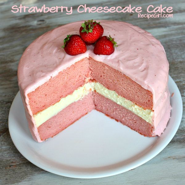 Strawberry Cheesecake Cake - The white layer in the middle is Cheesecake. The frosting is Strawberry Cream Cheese. My keyboard is covered in drool...