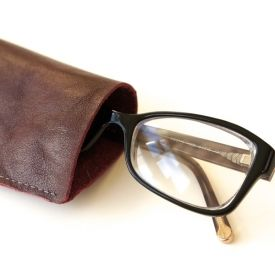Make your own leather glasses case using a scrap of leather and a home sewing machine. Simple instructions with tips for sewing with leather