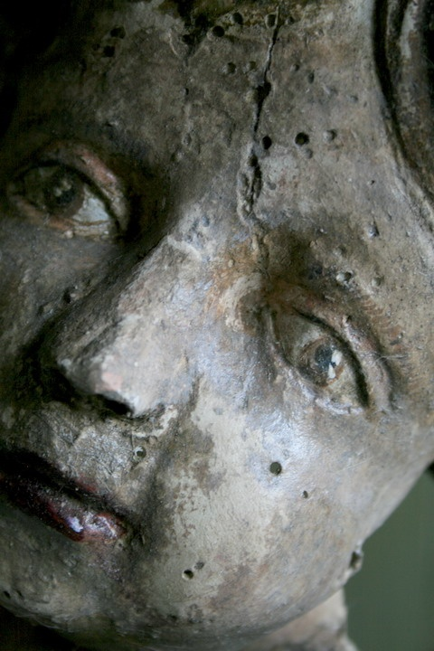 Detail of a paper mache faces angel.  by ELise Valdorcia-France