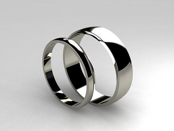 Matching titanium wedding band set by TorkkeliJewellery, $527.00