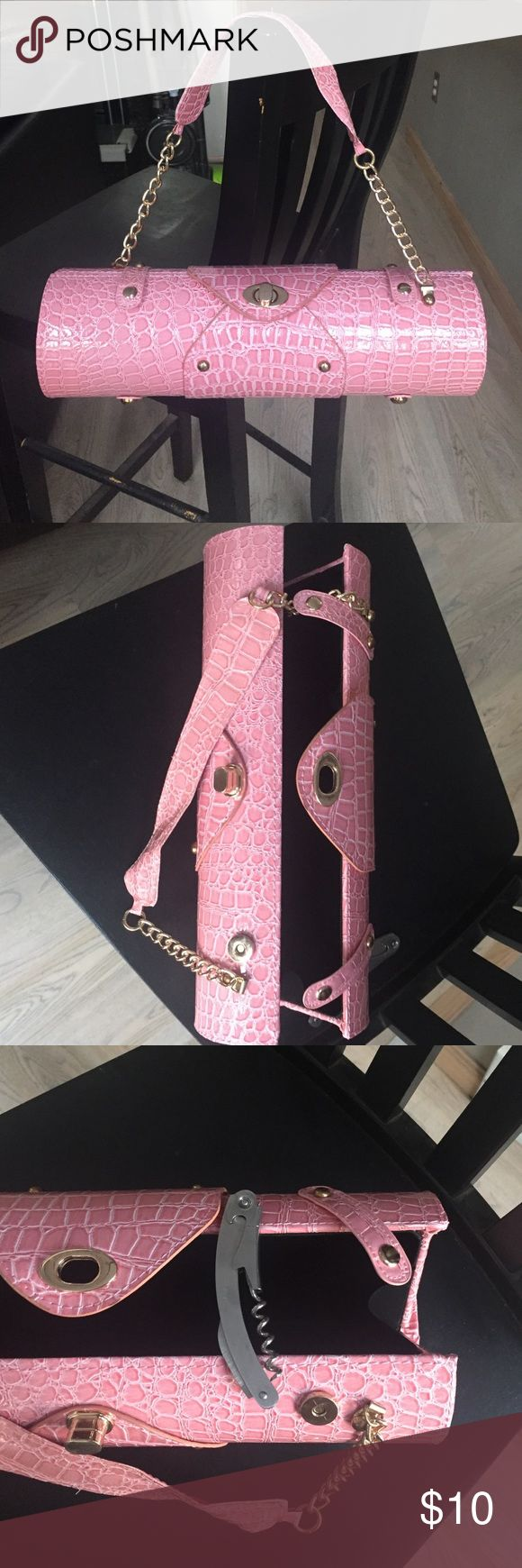 Adorable wine purse Bring your wine to a party or anywhere else in this cute little pink wine purse.  Comes with wine/ bottle opener. Bags